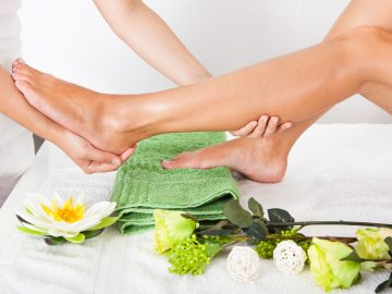 Close-up Of Woman Feet Receiving Foot Massage In Spa